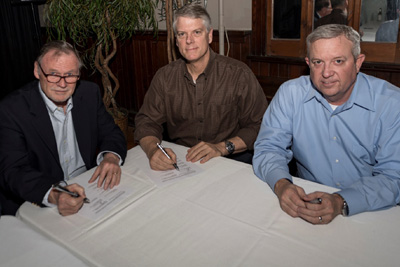 UFSPSO President Chip Strebeck and business agent Raynard Roberson signing the agreement with Ingalls management